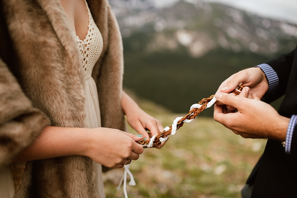 I love this knot tying braiding ceremony that Jessica and Edward did to celebrate their love! Estes Park, Colorado has some of the most beautiful wedding locations in Colorado! | Mountain elopement photos by adventure wedding photographer, Maddie Mae.