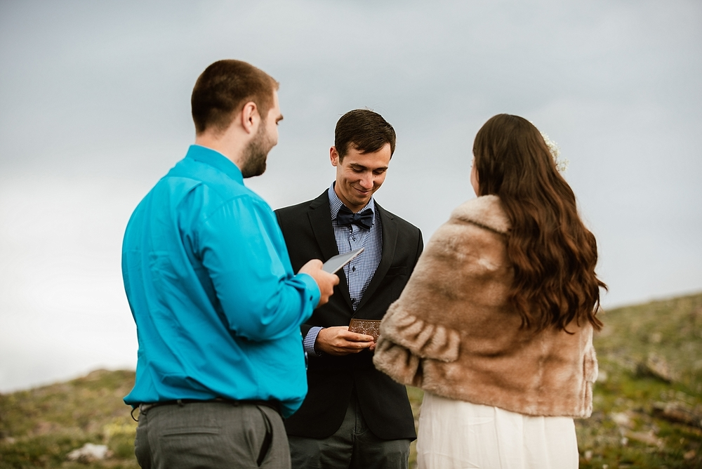 This intimate mountain elopement ceremony is exactly the wedding I've always dreamed of! Seriously love her gorgeous fur shawl! | Rocky mountain wedding photos by Colorado elopement photographer, Maddie Mae.