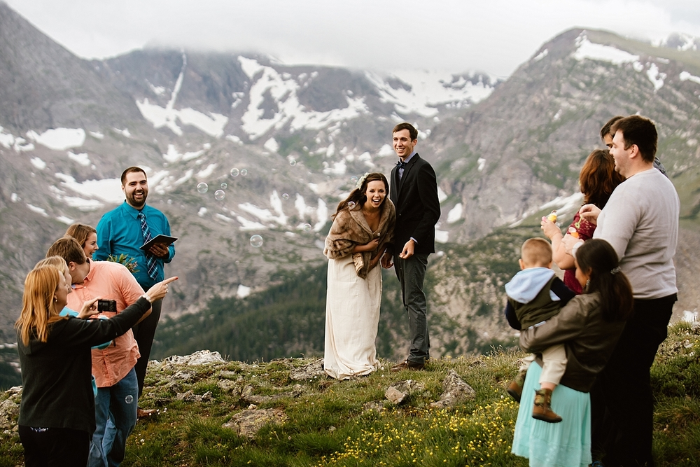 I'm so happy for this bride and groom! They eloped in the mountains with only their closest friends and family! | These perfect mountaintop elopement photos are by Colorado adventure wedding photographer, Maddie Mae.