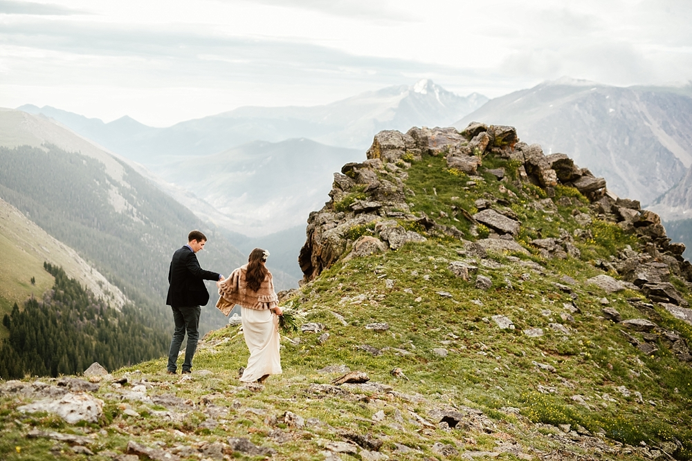 This epic cliffside wedding in Estes Park, Colorado turned out incredible! Trail Ridge Road (highway 34) has some of the most impressive views I've ever seenI didn't know there were such amazing wedding locations in Rocky Mountain National Park! | Colorado elopement photos by adventure wedding photographer, Maddie Mae.
