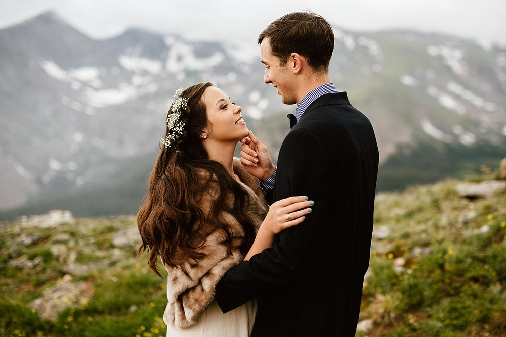 This is such a perfect wedding hairstyle for long hair! I really love the flowers in the bride's hair! | Trail Ridge Road elopement photos by Rocky Mountain National Park wedding photographer, Maddie Mae.