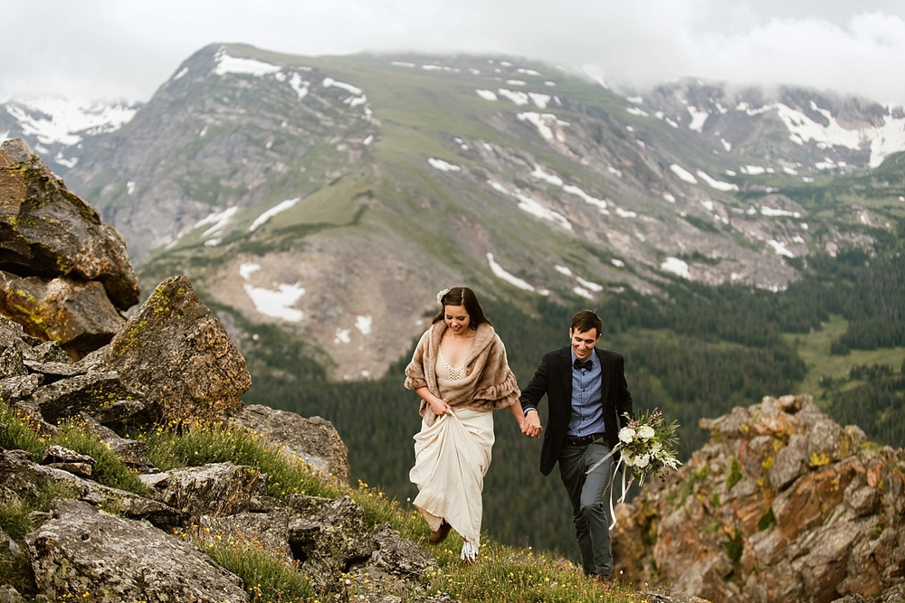Jessica and Edward got married in the winter up on a mountaintop in Estes Park, Colorado! I can't wait to get married here! | Trail Ridge Road elopement photos by rmnp wedding photographer, Maddie Mae.