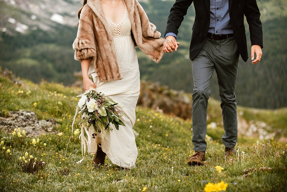 I love this white peony wedding bouquet! Such a cute wedding dress too! | Mountain elopement photos by adventure wedding photographer, Maddie Mae.