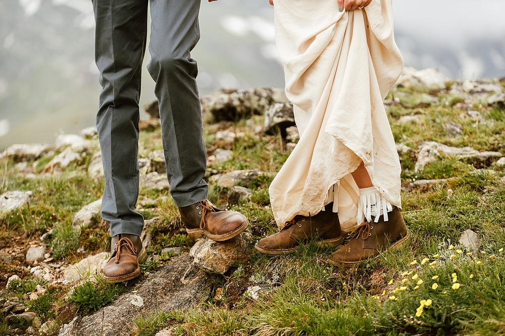 I love this couple's matching hiking boots wedding attire! Such a great idea for a hiking wedding in the mountains! | Hiking elopement photos by adventure wedding photographer, Maddie Mae.