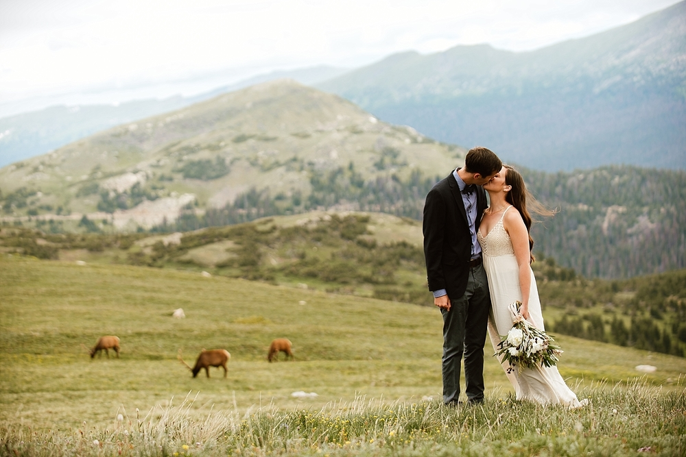 This is the most incredible wedding shoot I have ever seen! RMNP has the best mountaintop views had even has herds of elk roaming around to complete the epic background! | RMNP trail ridge road elopement photos by adventure wedding photographer, Maddie Mae.