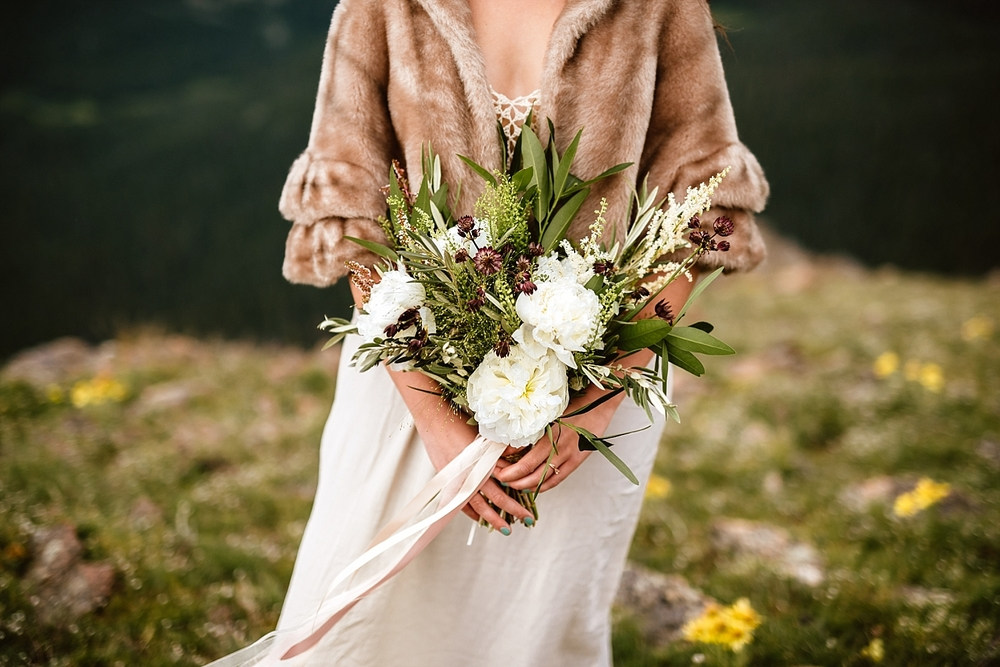 This white peony bouquet is exactly what I was looking for for my mountain elopement in Estes Park! | Bohemian mountain wedding bouquet by Lace and Lilies in Fort Collins, CO | Romantic mountain elopement photos by Colorado destination wedding photographer, Maddie Mae.