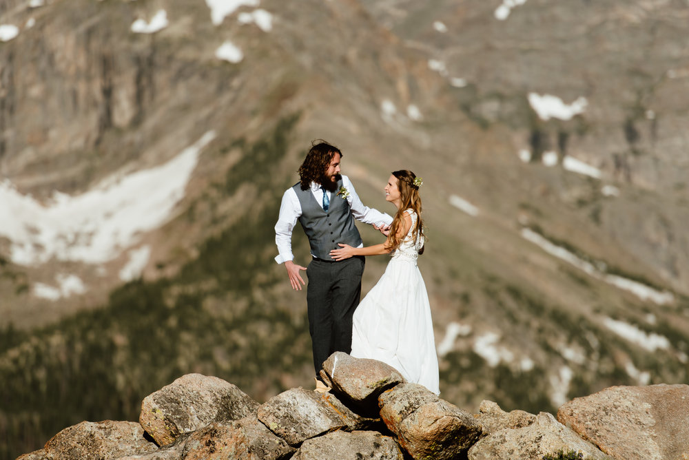 This is one of the most gorgeous first looks I've ever seen! Such gorgeous photography of this couple in RMNP! | RMNP elopement photos by Colorado adventure wedding photographer, Maddie Mae.