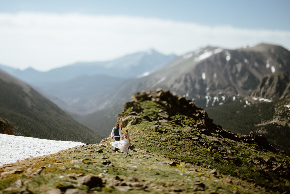 I am loving this amazing view in Rocky Mountain National Park! This secret spot on Trail Ridge Road in RMNP is the perfect spot for a wedding ceremony! | Mountain elopement photos by Colorado wedding photographer, Maddie Mae.