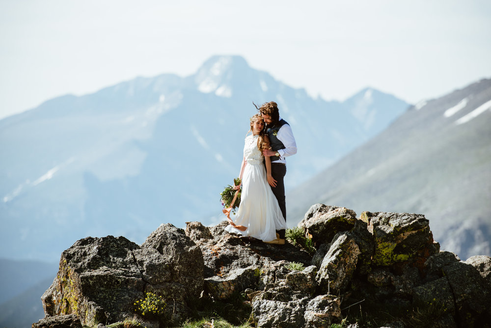 The mountain view at Erin and Graham's RMNP Trail Ridge Road elopement is ridiculous! I am so in love! | Mountain elopement photos by Rocky Mountain National Park wedding photographer, Maddie Mae.