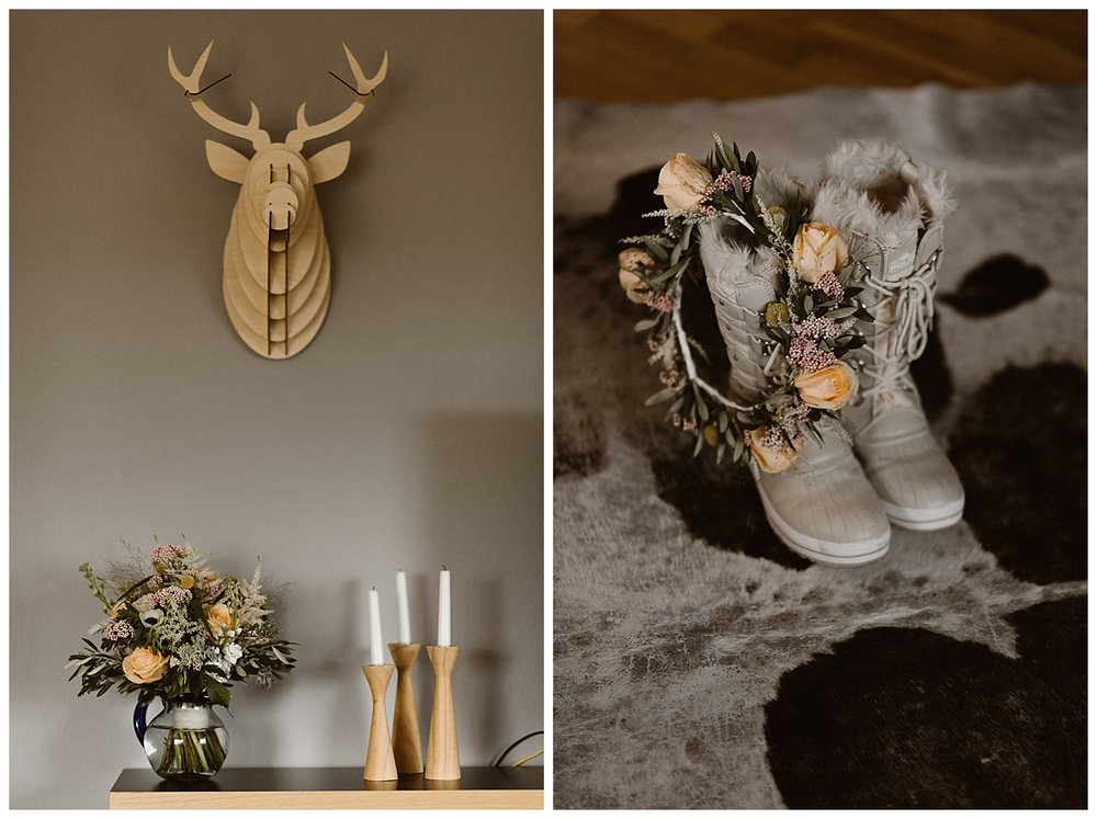 Filled with wood details, Julie's bright bouquet and fuzzy hiking boots waited for her to be dressed and ready to head out on her epic elopement through Iceland. Photos by intimate wedding photographer Maddie Mae.