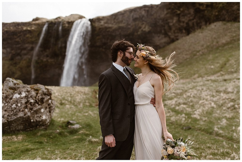 Julie and Tim paused one last time at Seljalandsfoss before wandering on to their next epic Icelandic location for their adventurous yet intimate elopement. Photos by traveling wedding photographer Maddie Mae.