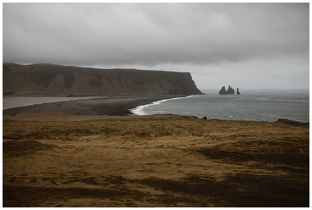 Moving on to Reynisfjara on the seaside. The moody tones of this epic intimate elopement were framed by the deep blues of the Icelandic ocean. Photos by traveling wedding photographer Maddie Mae.