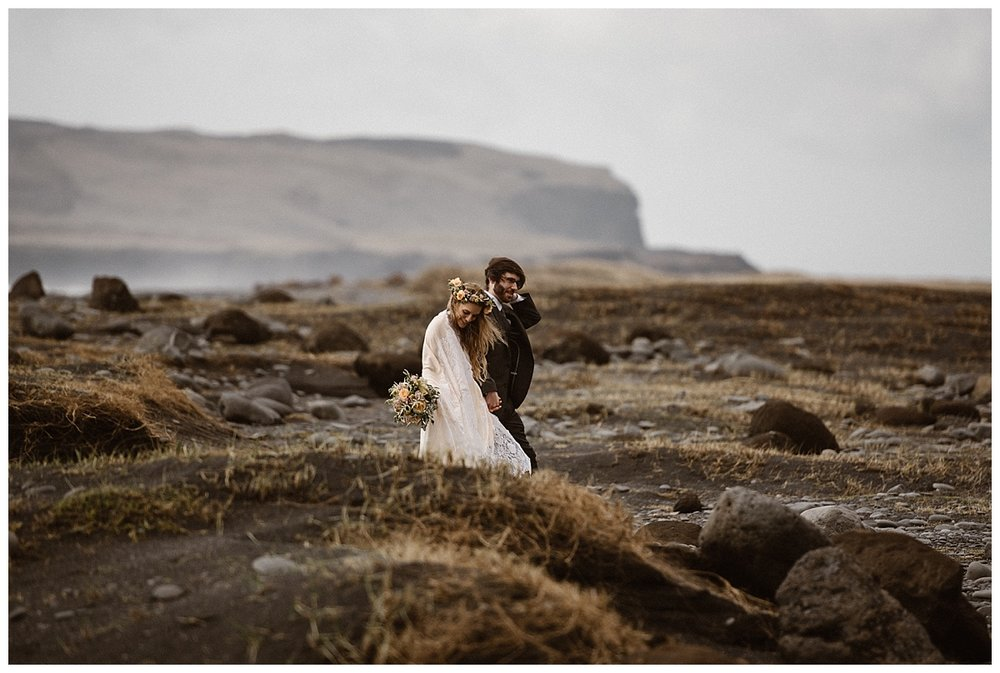 Reynisdrangar is one of Iceland's many epic elopement locations. Julie and Tim picked it's rocky beaches and sparse grass lands for one of their many places for their intimate wedding. Photos by traveling wedding photographer Maddie Mae.