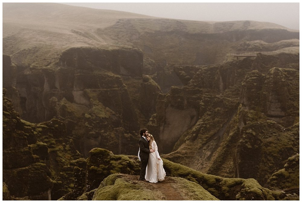 For epic landscapes as varied as they can be, Iceland is an amazing location for any intimate wedding.Fjadrargljufur Canyon, one of the many spots that Julie and Tim chose to celebrate their intimate elopement. Photos by traveling photographer Maddie Mae.