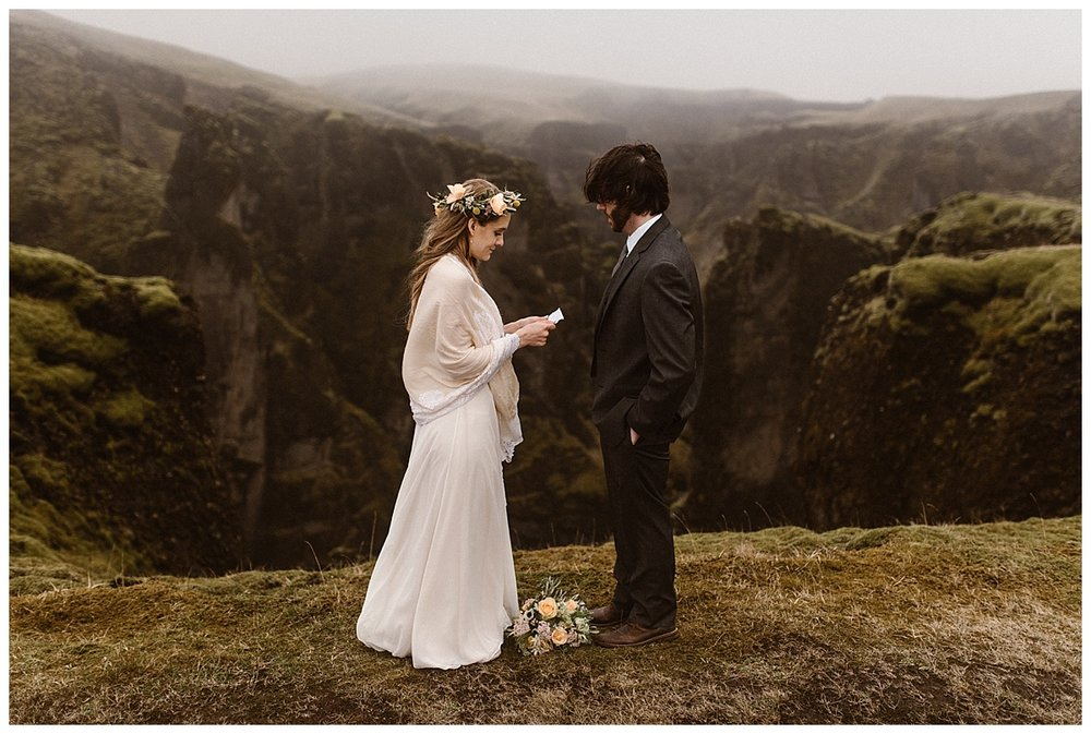 A light wind blew up Fjadrargljufur Canyon as Julie began her personalized wedding vows. The only witness to their intimate elopement was their traveling wedding photographer, Maddie Mae.