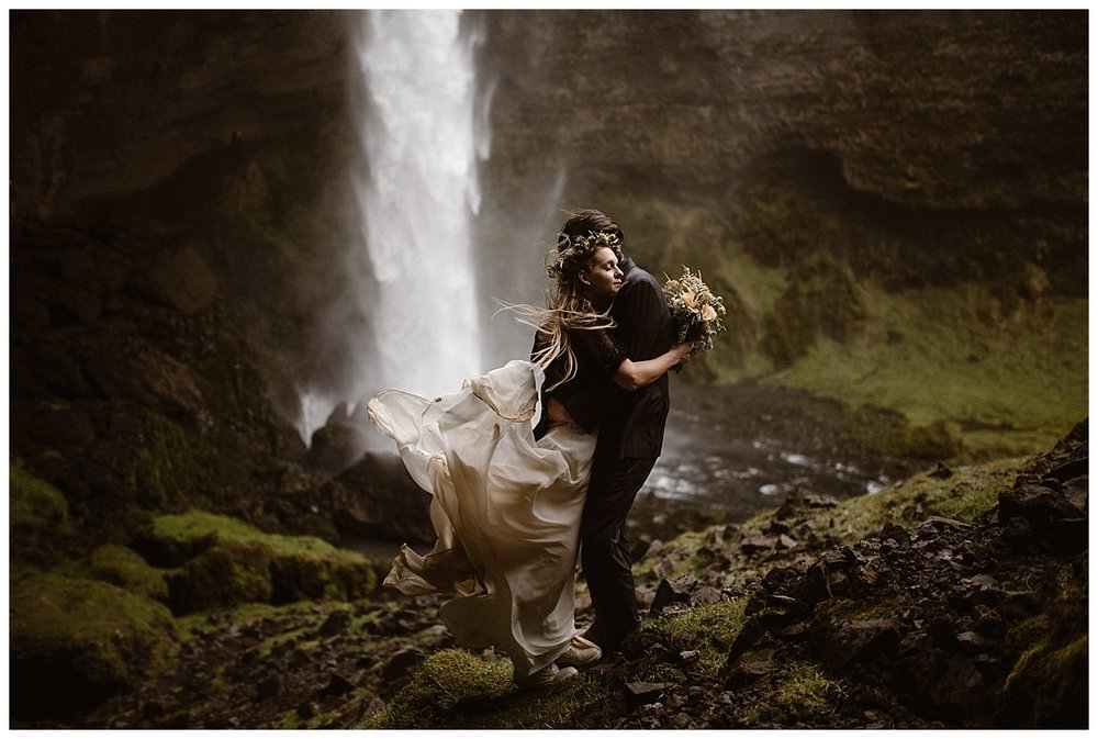 With the waterfall rushing and the wind blowing, Tim whispered his promises to Julie for a lifetime of love and adventure - just like the one they were on in Kvernufoss, Iceland for their intimate elopement. Photos by Maddie Mae Photography.