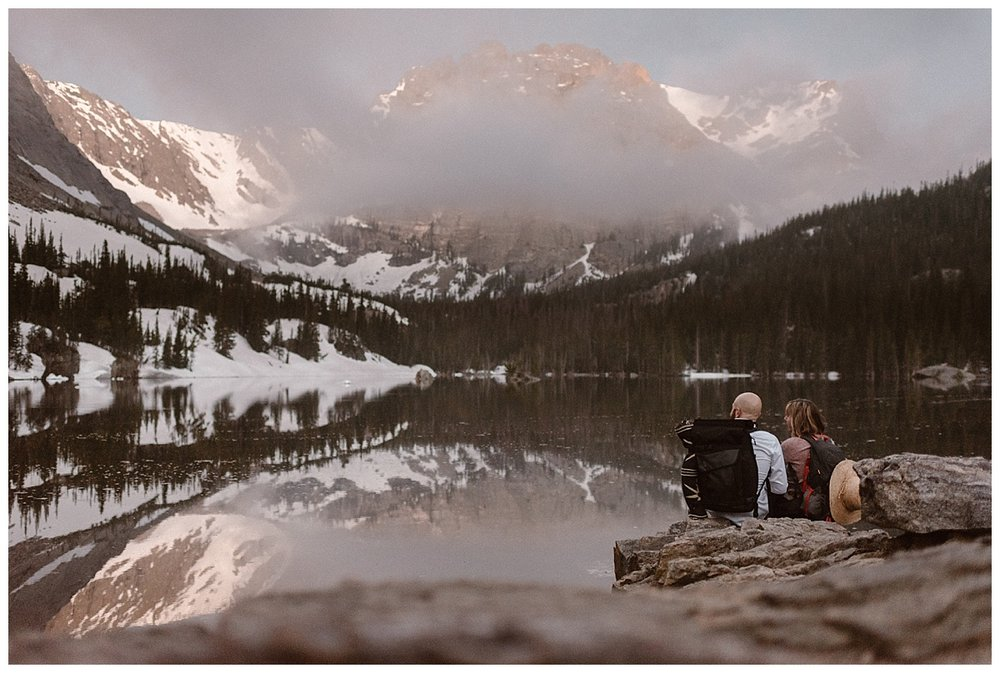 As they reached Loch Vale the sun was just starting to rise, lighting up the Colorado Rockies with that infamous pink alpine glow. This intimate hiking elopement through Rocky Mountain National Park captured by wedding photographer Maddie Mae.