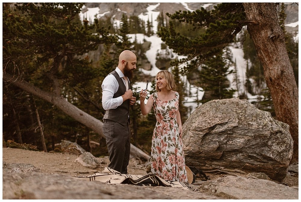 Putting the final touches on his tie, Sarah held her compact mirror for Justin. This adorable couple threw tradition to the wind and eloped in Rocky Mountain National Park with only their intimate wedding photographer, Maddie Mae as their witness.