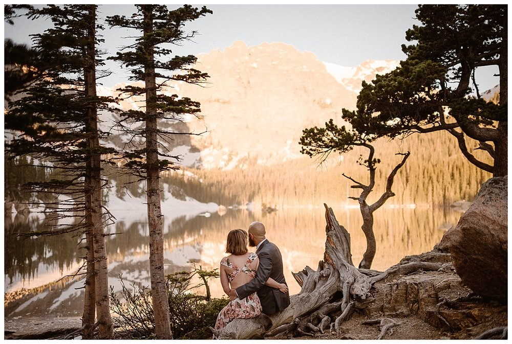 Taking a moment for just themselves surrounded by early spring trees they watched the sun rise over Loch Vale as the alpine glow slowly melted away to reveal a gorgeous sunny day in RMNP. Photos of this intimate hiking elopement by Colorado native, Maddie Mae.