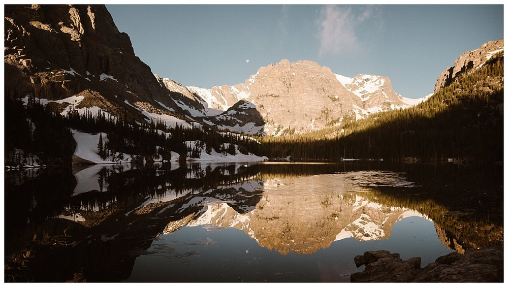 It's a several mile hike up to Loch Vale, one of the most stunning locations in Rocky Mountain National Park for an intimate wedding or private elopement. The views in early spring are stunning with snow still on the mountains but usually giving way to lovely sun shining days. Photos of this intimate elopement captured by Maddie Mae.