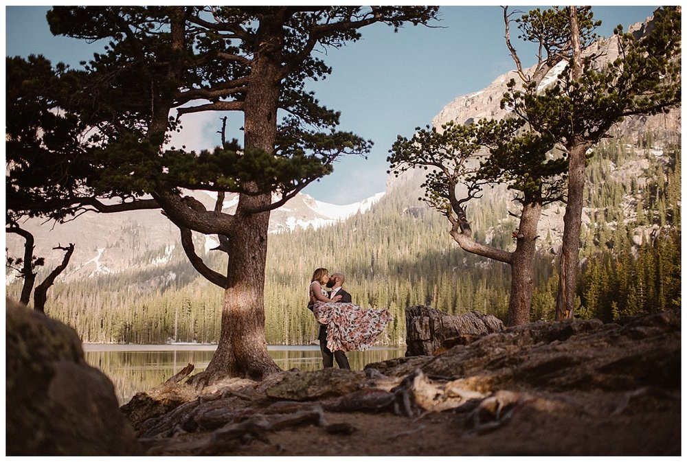 Justin swept Sarah off her feet, literally carrying her over some of the knotted tree roots surrounding Loch Vale in RMNP where they had just eloped. This sunrise hiking elopement captured by intimate wedding photographer Maddie Mae.