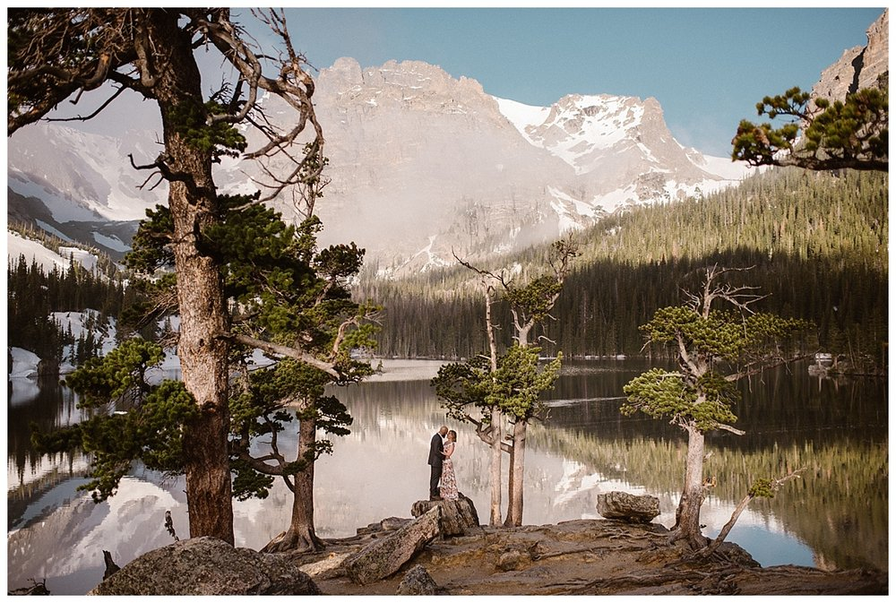The air was so still and the Loch reflected the massive Rocky Mountains behind them. RMNP is one of the most varied and stunning places for an intimate wedding or private elopement. This adventurous sunrise elopement through Rocky Mountain National Park was photographed by Maddie Mae Photography.