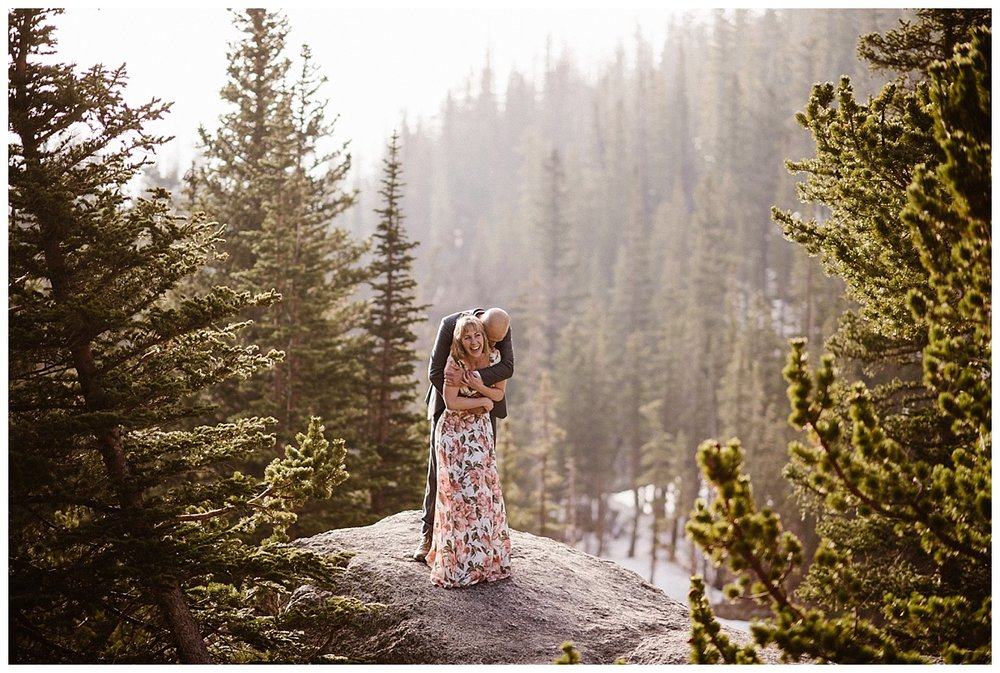 Through the forests of RMNP this adventurous couple hiked (and giggled) their way through the day of their intimate elopement. Their ceremony up Loch Vale where the alpine glow makes the mountains pink almost mimicking Sarah's floral Reformation dress. Photos by traveling wedding photographer Maddie Mae.