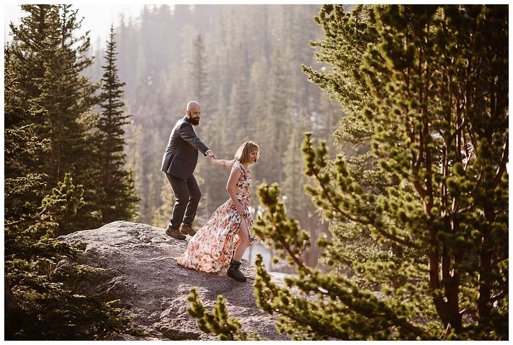 Leading her bearded groom down the large rocks along the trail, Sarah and Justin continued their elopement hike through Rocky Mountain National Park. Picking an early spring day they said their intimate wedding vows at Loch Vale before hiking through the park with their intimate wedding photographer, Maddie Mae.