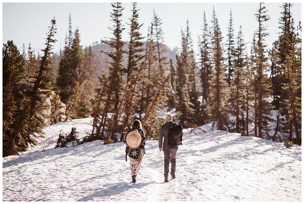 Wandering into the snowy foothills Sarah and Justin hiked their way onwards to a different vantage point of the Loch before moving on to Sprague Lake for their intimate adventure elopement. Photos by traveling wedding photographer Maddie Mae.