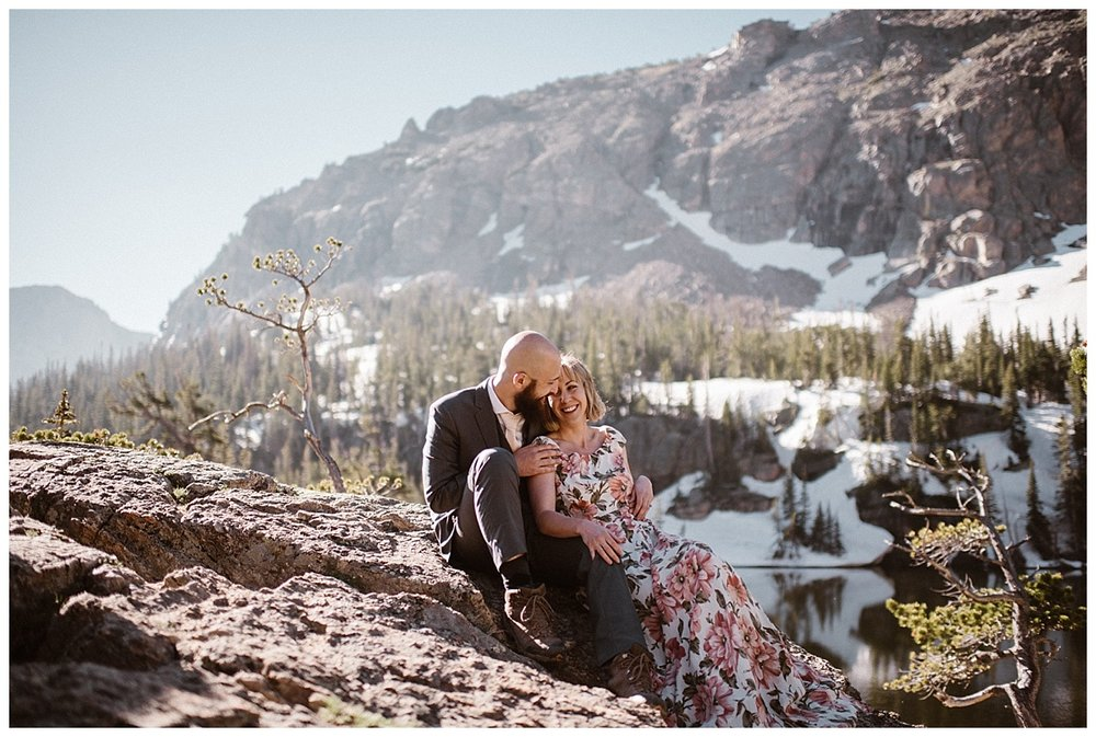 Taking a seat to take in the views of Loch Vale, Sarah and Justin were smiles all day long at their adventurous elopement through RMNP with intimate wedding photographer Maddie Mae at their heels.