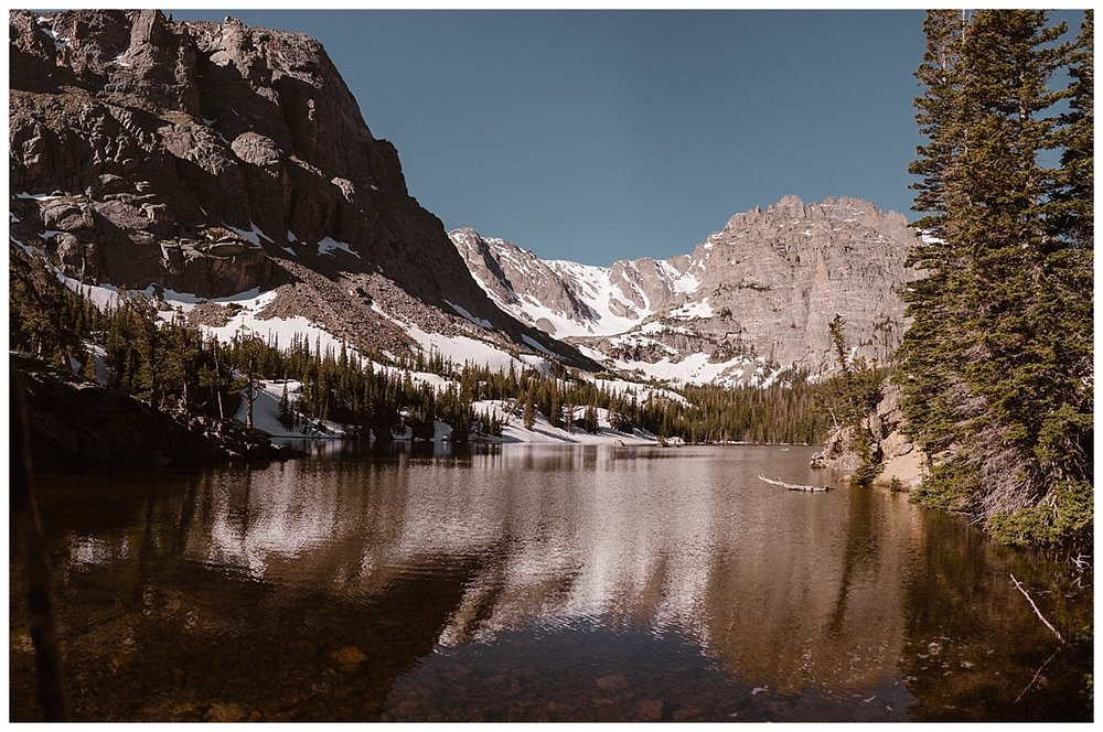 Rocky Mountain National Park is home to many hidden lakes and forest valleys. In spring the snow is still visible on the foot hills of the snow capped Rockies making it a stunning location for a wedding or intimate elopement. Photos of this adventurous elopement by Maddie Mae Photography.