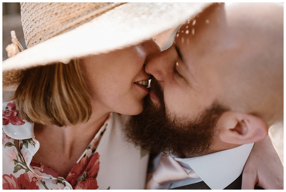 One last kiss in the forests surrounding Sprague Lake in Rocky Mountain National Park before it was time to hike down and complete their adventurous wedding day. This non-traditional intimate elopement photographed by traveling wedding photographer Maddie Mae.