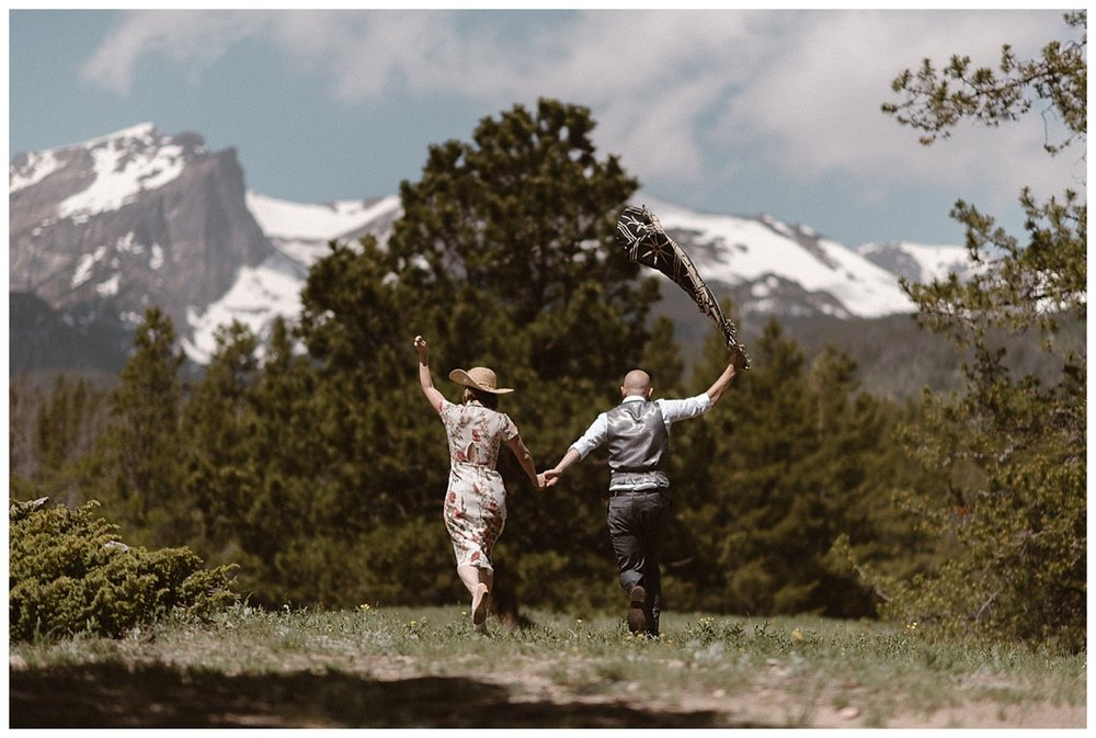 And off they ran into the green meadows below the high alpine terrain where earlier that morning they had eloped with no one around but their intimate wedding photographer, Maddie Mae.