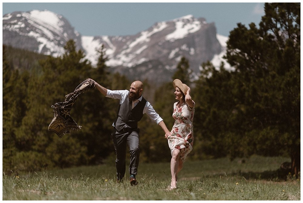With the wind blowing, this adventurous couple ended their all day elopement through Rocky Mountain National Park just past Sprague Lake. Their intimate wedding photographer Maddie Mae, their only witness to their non traditional wedding day.