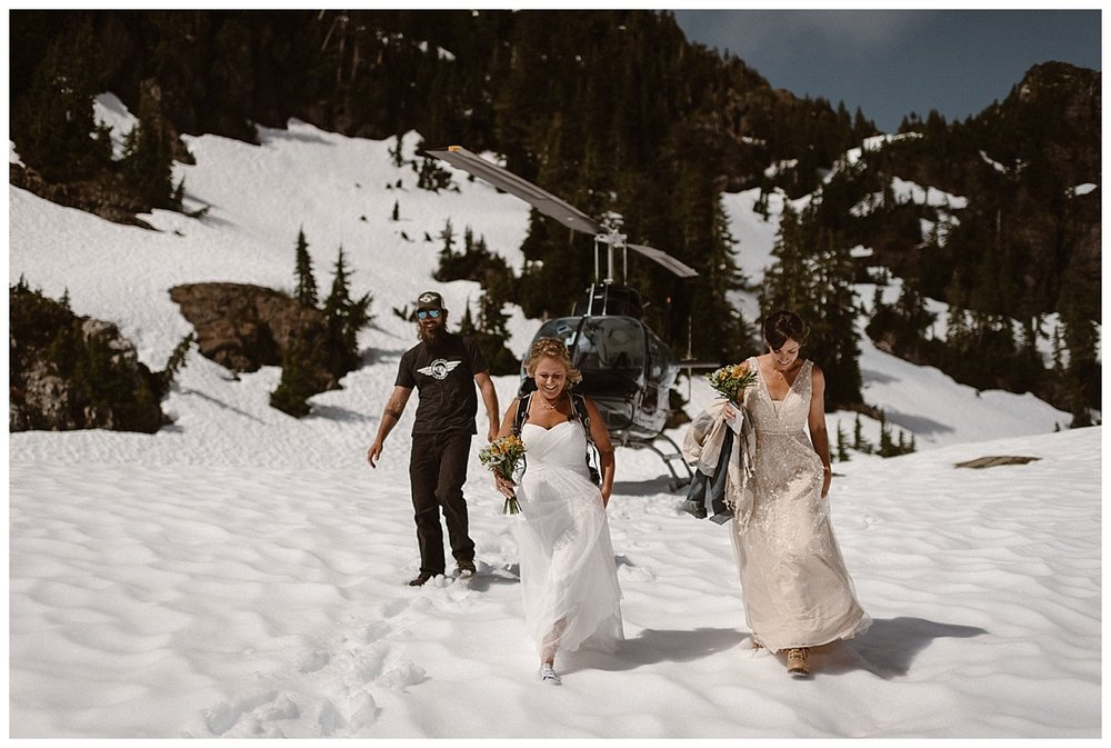 Trekking through the snow in their wedding dresses, bouquets in hand, these brides made their way to their intimate and private mountain top ceremony location in Tofino BC with traveling wedding photographer Maddie Mae in tow.