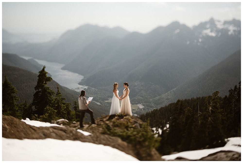 With their officiant standing with them overlooking Tofino BC, Kari and Karin said their intimate wedding vows at their adventurous helicopter elopement with photographer Maddie Mae snapping away.