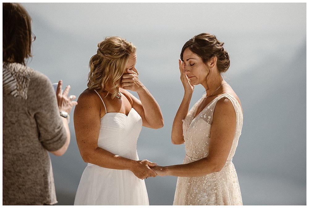 As their officiant read on both brides got emotional. This intimate and adventurous helicopter elopement through Tofino BC photographed by traveling wedding photographer Maddie Mae.