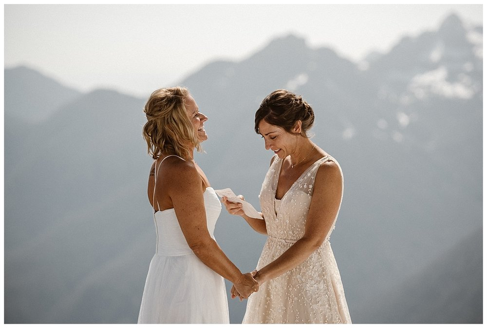 Breaking the mood, Karin began her handwritten vows. Her sense of humor is what Kari first fell for. This intimate Tofino BC elopement captured by traveling wedding photographer Maddie Mae.