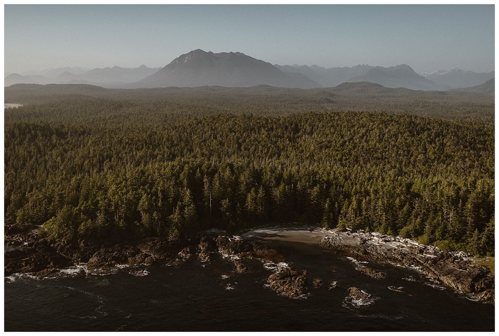 They headed back towards Tofino proper. The view a sea of green pine trees butted up against a rocky beach. Kari and Karin threw tradition to the wind and eloped all around Tofino via helicopter. Photos of their intimate elopement by Maddie Mae Photography.