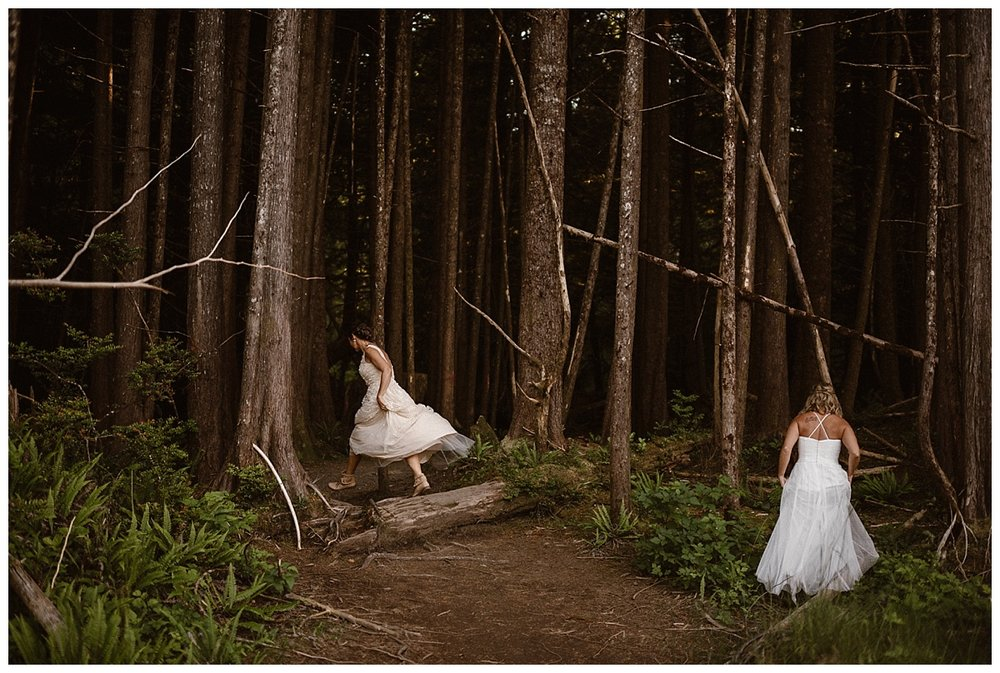 They wandered into the lush green forest that butted up against the beach in Long Beach Tofino BC where they had landed after their epic helicopter elopement. Photos of these adventurous brides by traveling wedding photographer Maddie Mae.