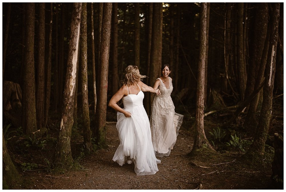 Kari lead Karin out the woods and down towards the beach of Tofino BC. The afternoon sunlight making them glow as they adventured on their intimate elopement. Photos of their epic adventure by traveling wedding photographer Maddie Mae.