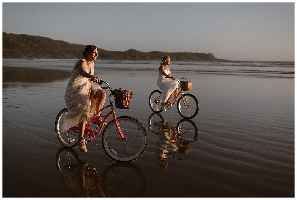 They grabbed some rented bikes and went cruising down the beach in Tofino BC. Photos of this epic elopement by traveling wedding photographer and adventure junky Maddie Mae.