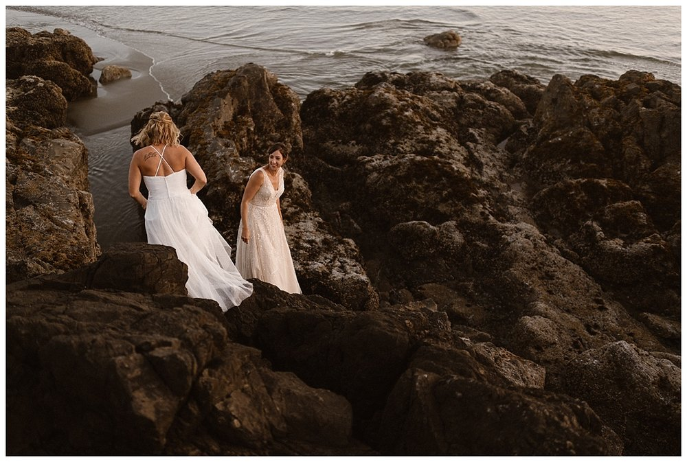 Kari and Karin were full of energy and continued on their adventure by wandering down the rocky cliffs to the Tofino beach as their intimate elopement was coming to an end. Photos by traveling wedding photographer Maddie Mae.