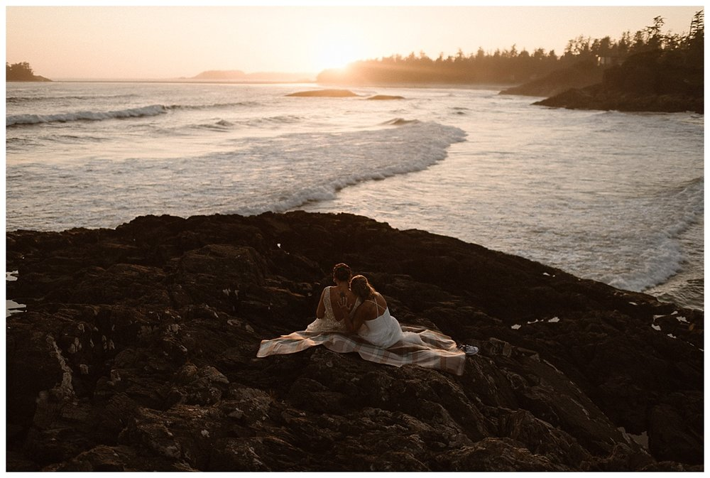 The sun went down as Kari and Karen finished watching the surprise video from their families back home. This adventurous elopement through Tofino BC captured by intimate wedding photographer Maddie Mae.