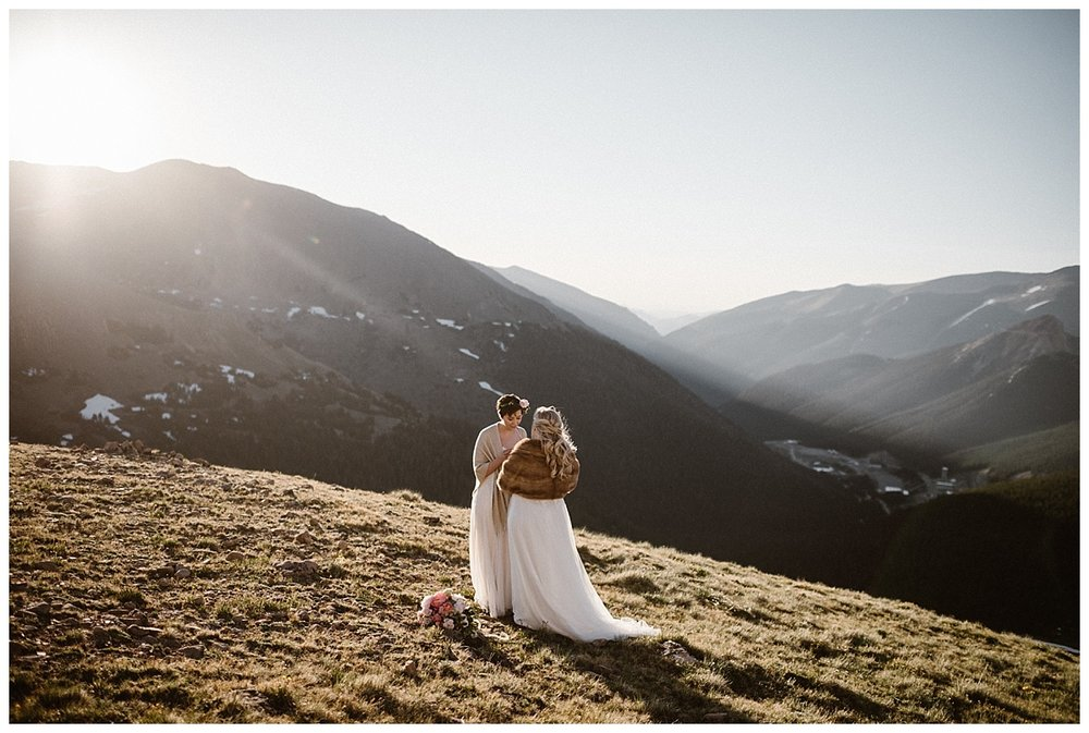 Their intimate elope ceremony began as the sun crested the San Juan mountains near Winter Park Colorado. These adventurous brides opted out of tradition and self solemnized with only their traveling wedding photographer, Maddie Mae, looking on.