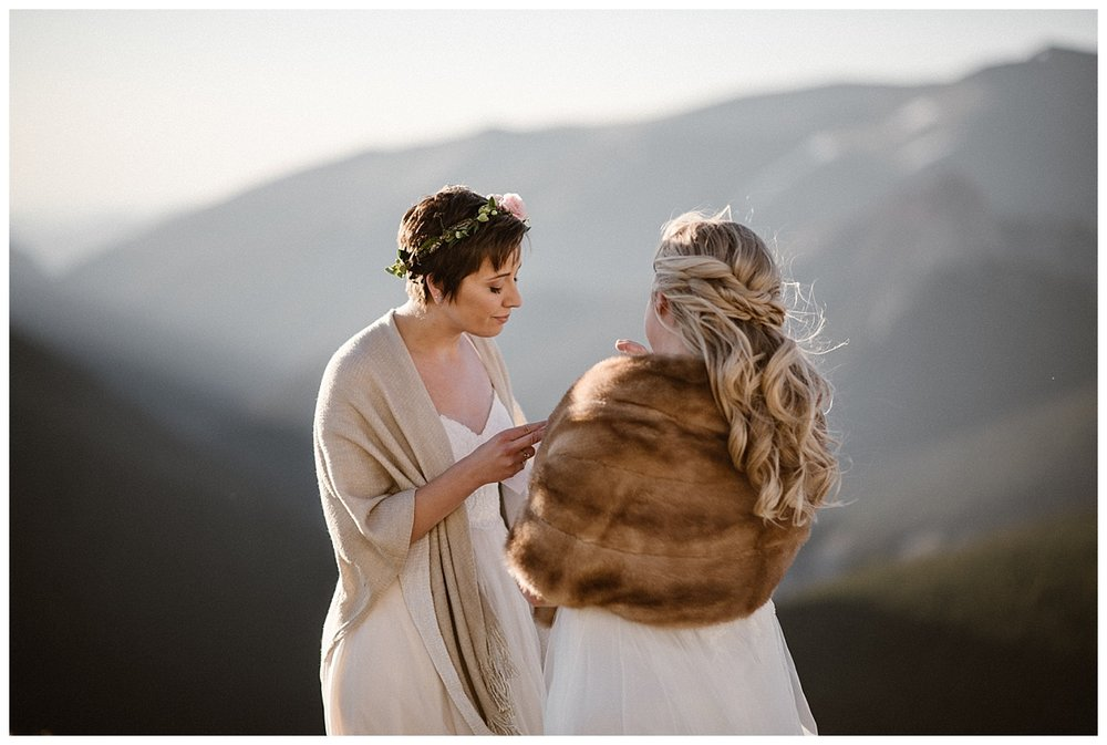 The wind blew as they said their vows in private high up Jonas Pass in the San Juan Mountains. This intimate elopement near Winter Park was photographed by Colorado native, Maddie Mae.