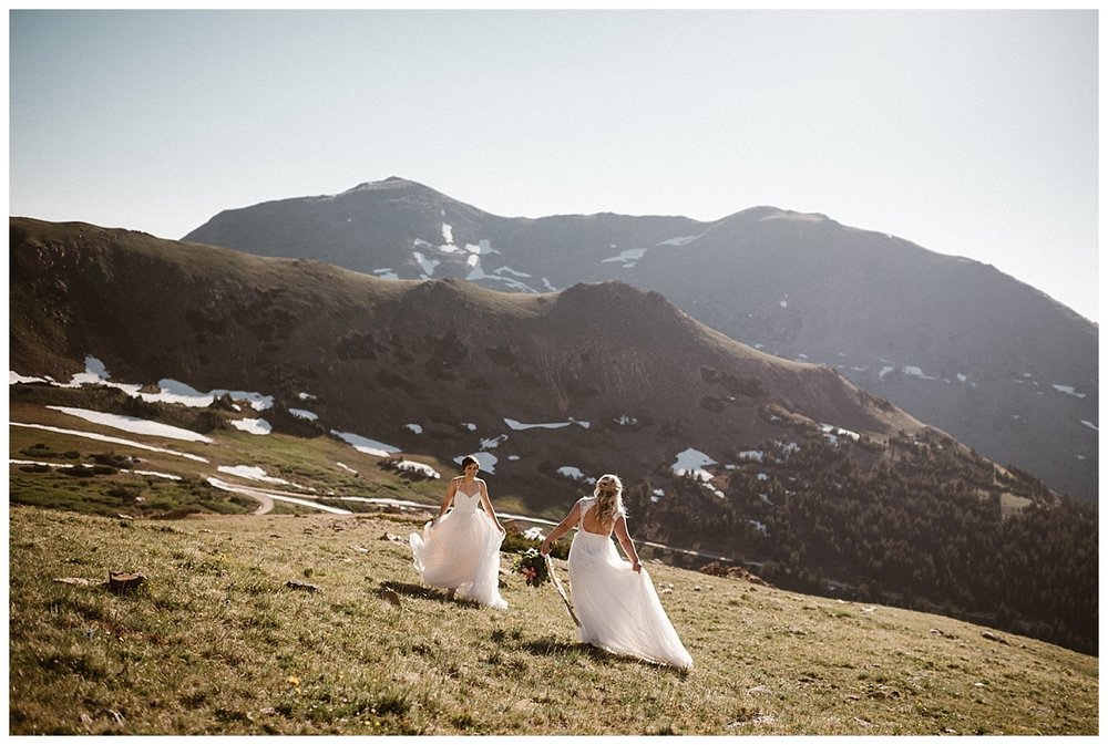 They frolicked like faeries high in the alpine terrain up Jonas Pass. Their intimate sunrise elopement near Winter Park, Colorado was photographed by traveling wedding photographer Maddie Mae.