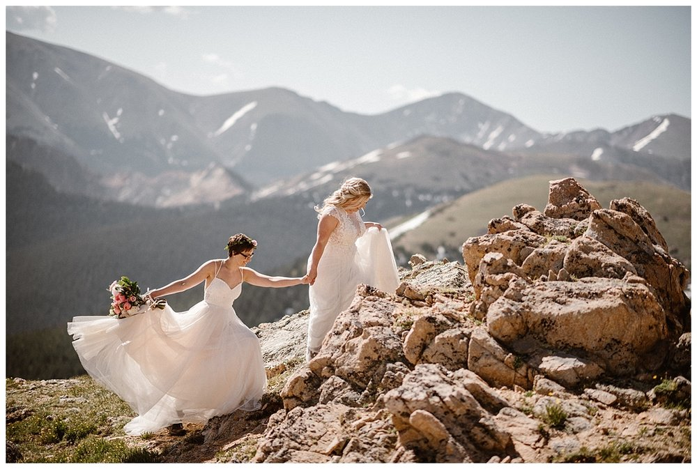 Making their way up a stack of jagged rocks for a better view of the valleys below Jonas Pass, Dona and Malisa opted for adventure over tradition for their intimate sunrise elopement. Their only witness their traveling wedding photographer Maddie Mae.