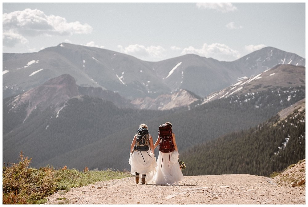 With the sun high in the sky, these adventurous brides hiked their way back down Jonas Pass to begin the real adventure of marriage together. This intimate elopement through the San Juan mountains captured by traveling wedding photographer Maddie Mae.