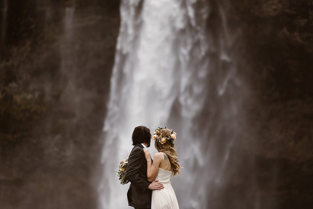 With Seljalandsfoss waterfall as their backdrop, Tim and Julie paused to share an intimate moment with not a soul around them, except for their traveling wedding photographer Maddie Mae.